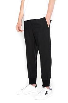 NEIL BARRETT pantaloni slim vita bassa con elastico sul fondo